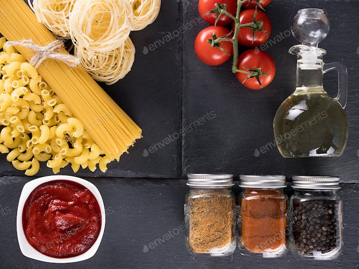 Top view variety of raw uncooked pasta