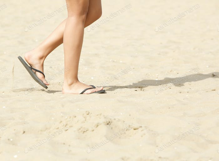 Walking on beach with flip flops
