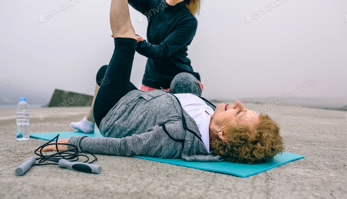 Senior woman with personal trainer