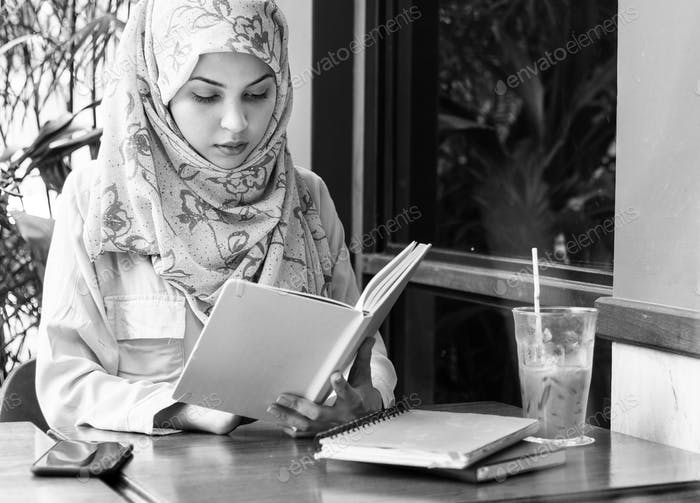 Islamic woman reading book