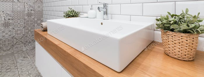 Big porcelain sink in modern bathroom