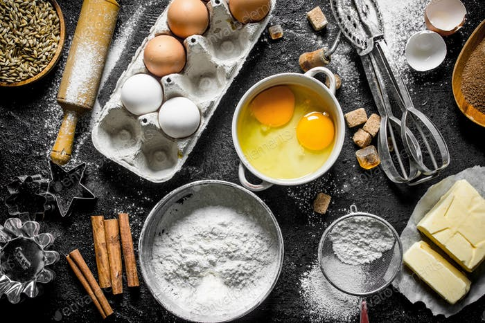 Baking background. Flour with eggs, butter and cinnamon.