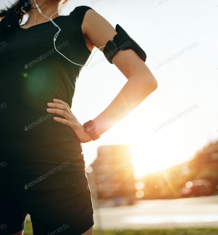 Woman taking a break from running workout
