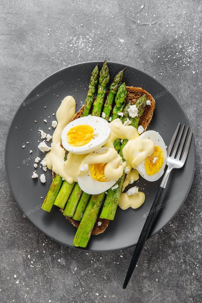 Tasty toast with asparagus, eggs and sauce