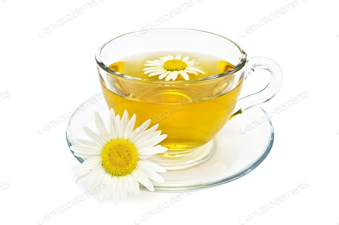 Herbal tea in a glass cup with daisies