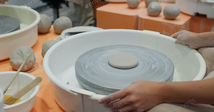 Prepare to make a clay pot in studio