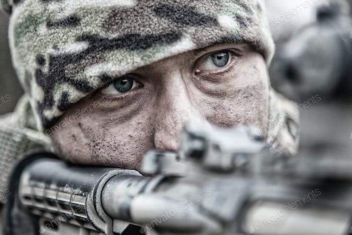 Army soldier infantryman shooting with service rifle