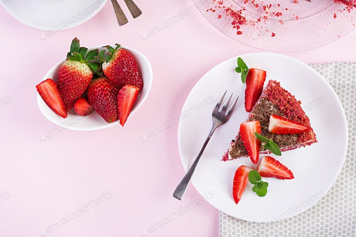 Red velvet cake on a pink background. Tea drinking. Table setting. Top view