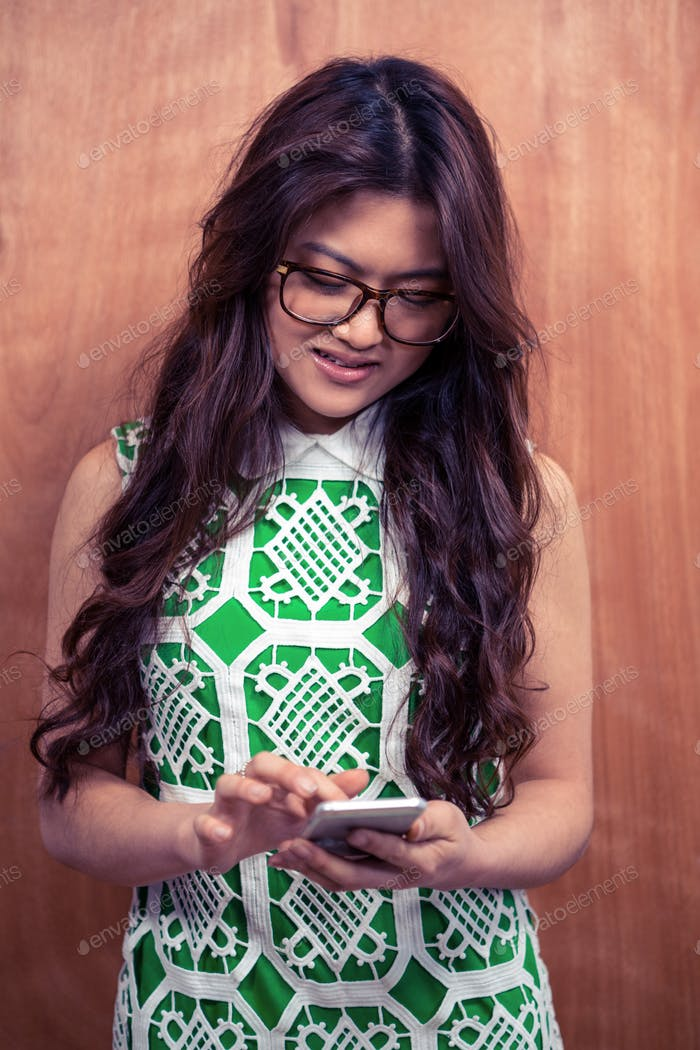 Asian woman with eyeglasses using smartphone