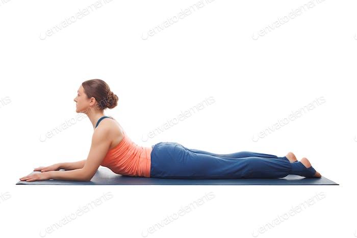 Sporty fit yogini woman practices yoga asana salamba bhujangasan