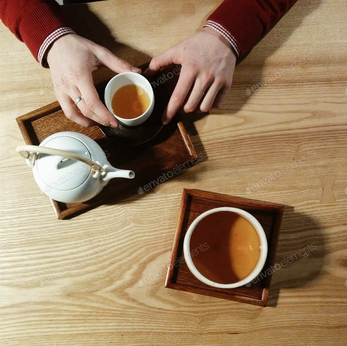 Meeting with a friend over a cup of green tea