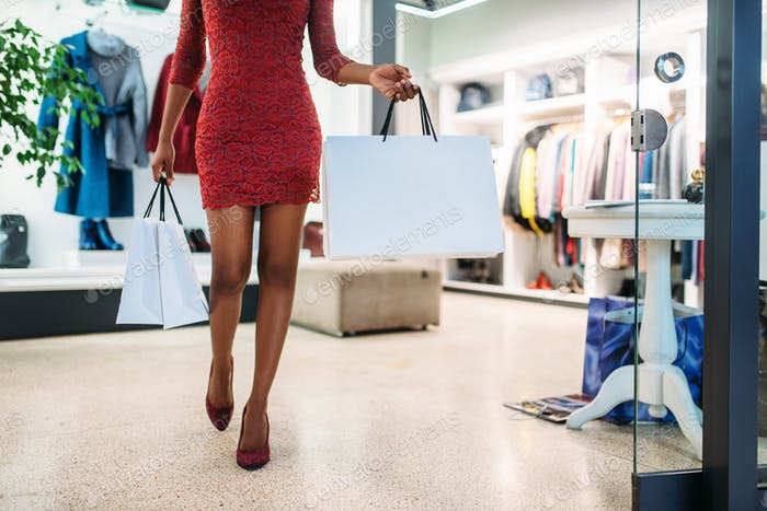 Attractive black lady in red dress, shopping