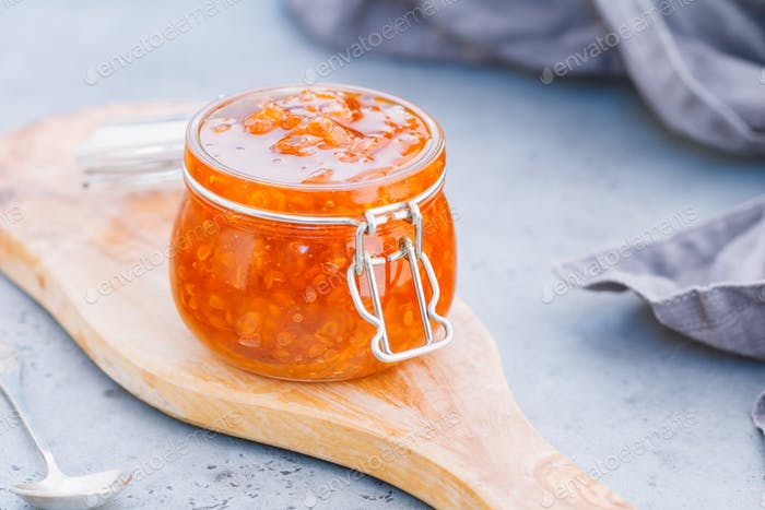 Glass jar with cloudberry jam. Nordic cuisine.