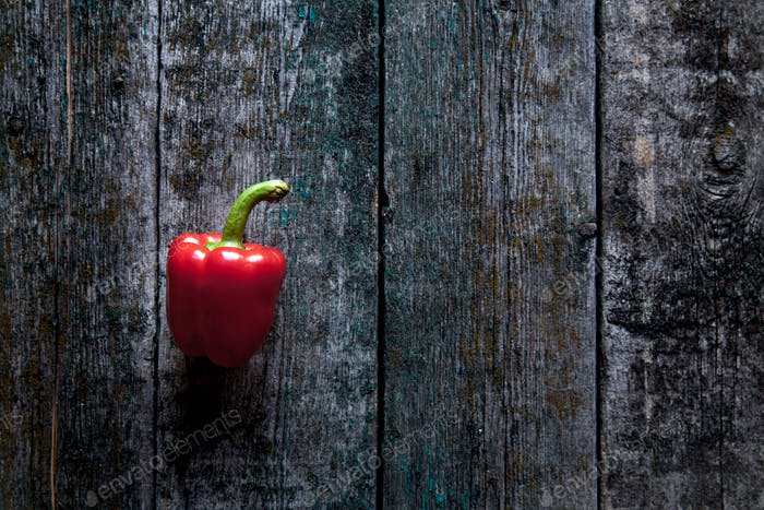 Red bell pepper background on the wooden background
