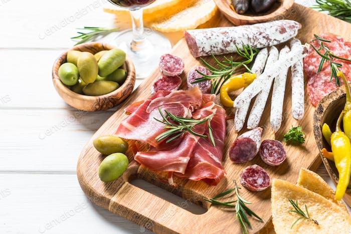 Antipasto delicatessen - meat, cheese and wine