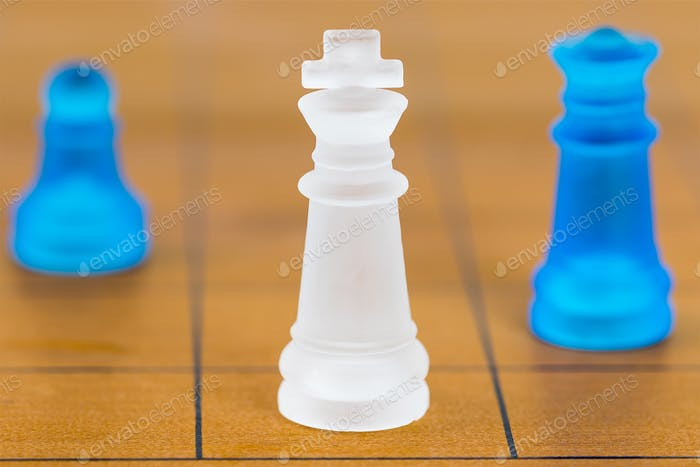 Chess glass on a wood chessboard_
