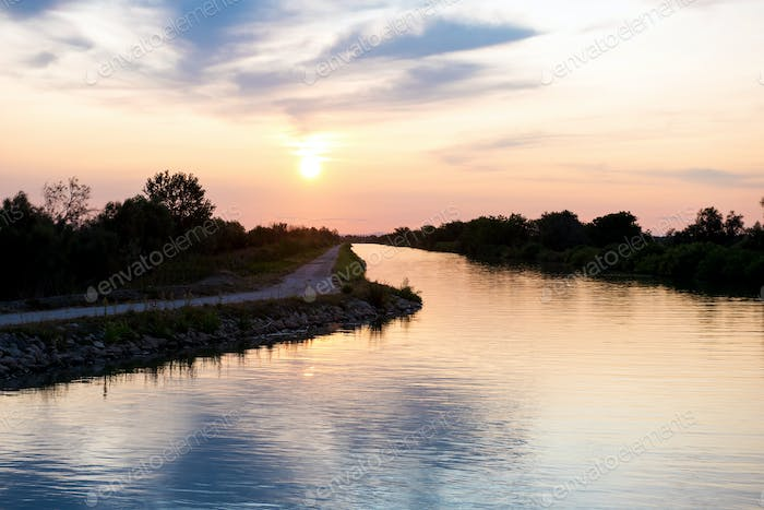 Sunset over a canal in the Camargue, France
