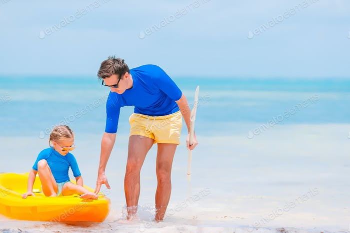 Father and kids at tropical beach. Family playing with beach toys