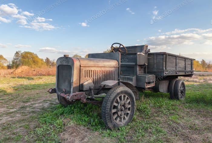 Vintage truck with wooden bench under the driver in a rural location