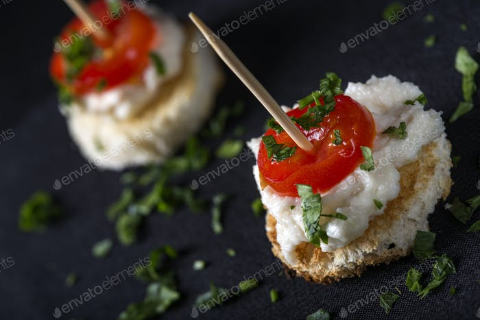 Appetizer with roe salad and tomato slices