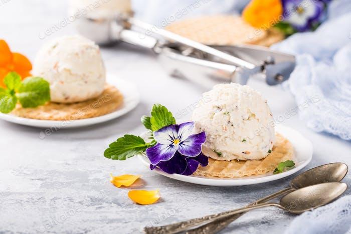 Vanilla ice cream with edible flowers