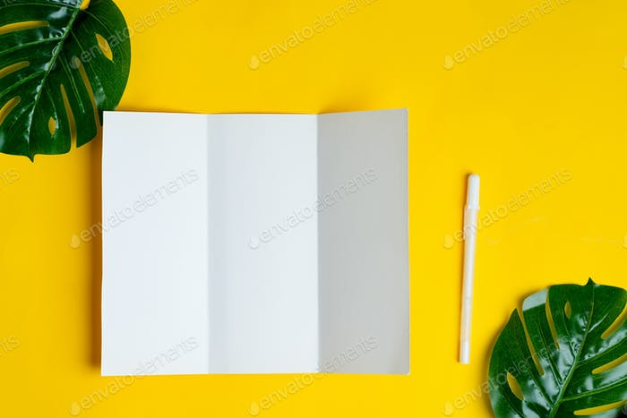 Minimal trifold brochure template above yellow background