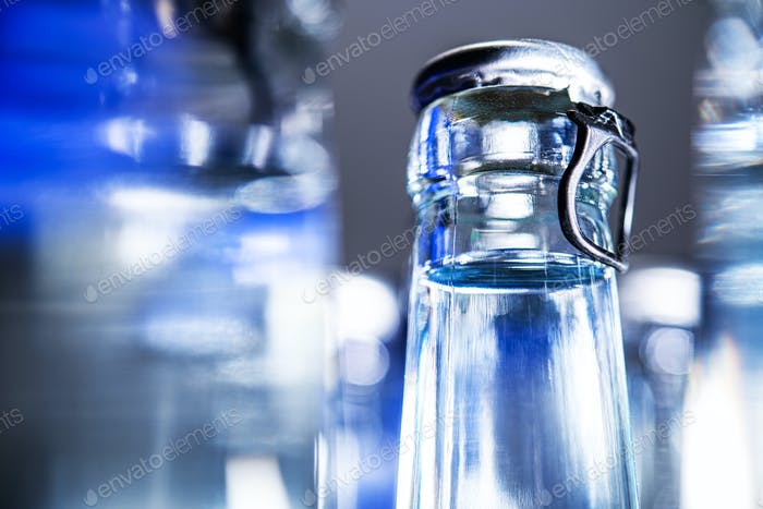 Mineral Water Glass Bottles With Tops.