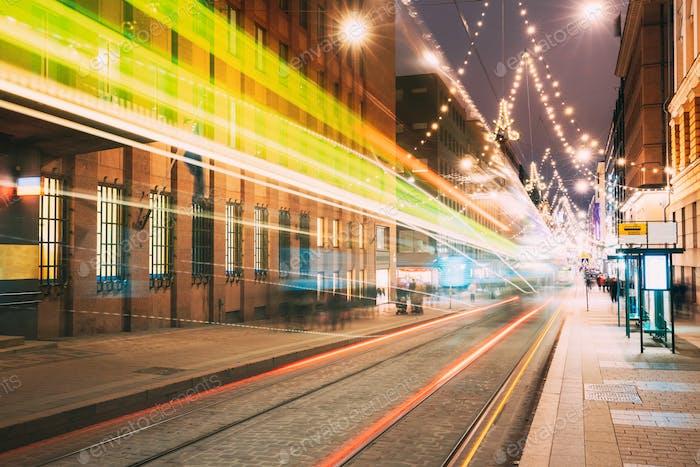Helsinki, Finland. Tram Departs In Motion Blur From Stop On Alek