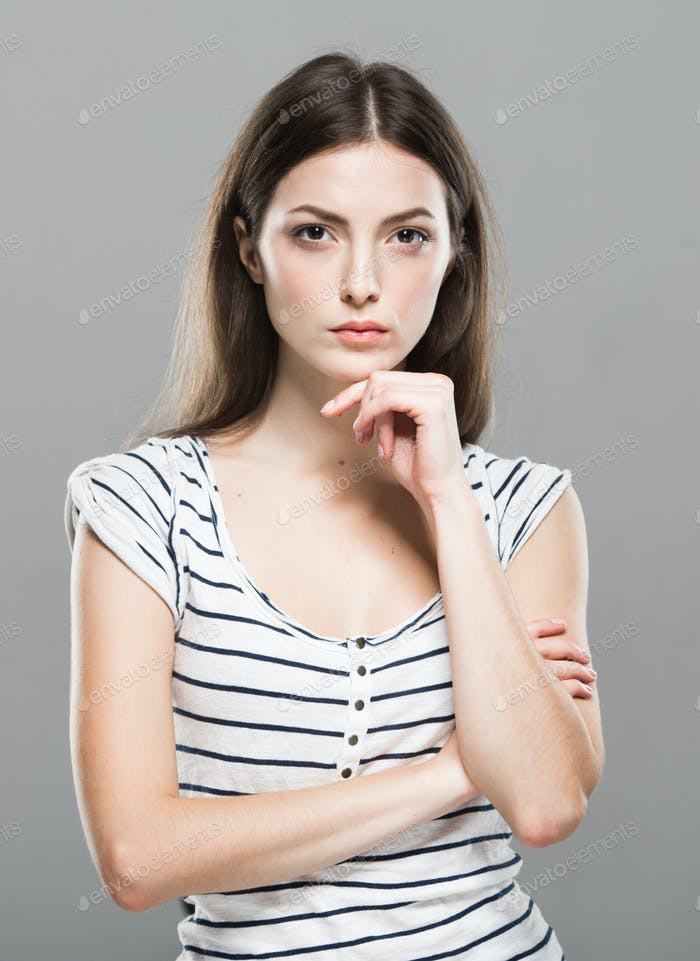 Surprised woman. Emotional face woman portrait, beautiful female over gray background posing