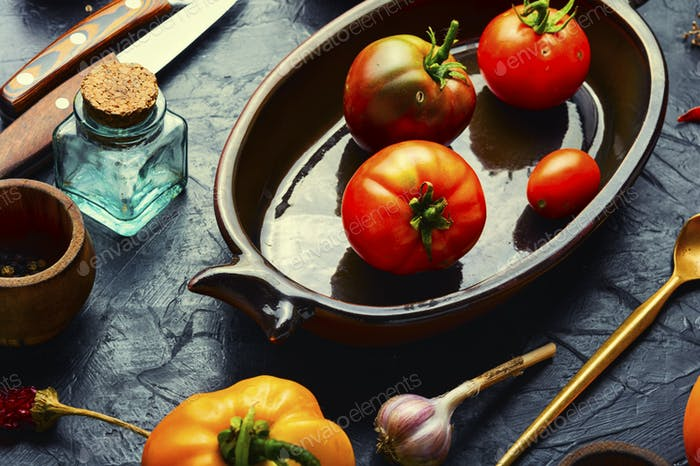 tomatoes and ingredients for cooking pickled