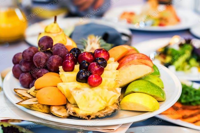 Beautiful fruit plate on festive table
