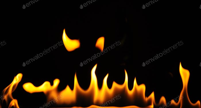 Close-up flames of an alcohol burner on a dark background