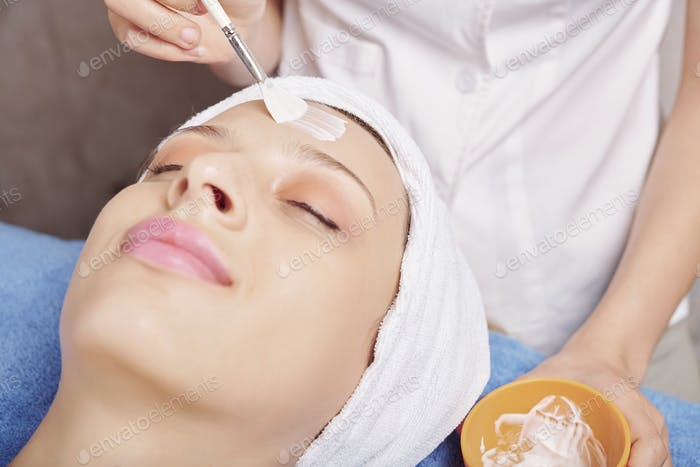 Woman enjoying beauty procedure