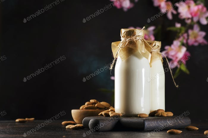 Vegan almond milk in bottles, closeup