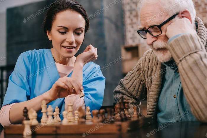 Nurse and senior man passionate about chess
