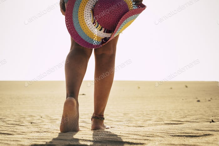 barefoot naked feet of caucasian woman walking on the sand in summer vacation at the beach