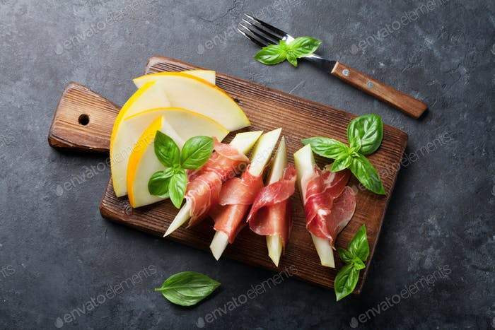 Fresh melon with prosciutto and basil