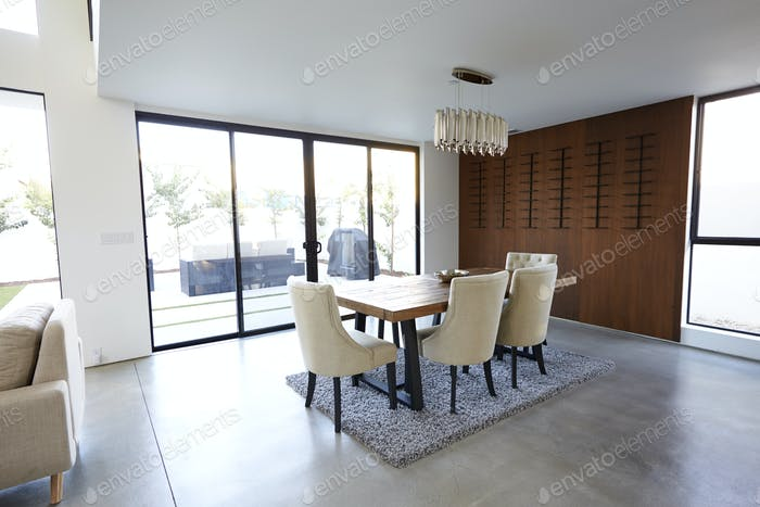 Dining Table And Chairs In Stylish And Contemporary Empty Home
