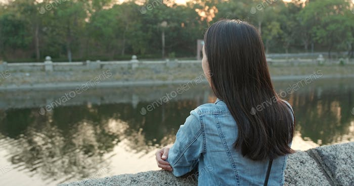 Young woman looking far away at outdoor