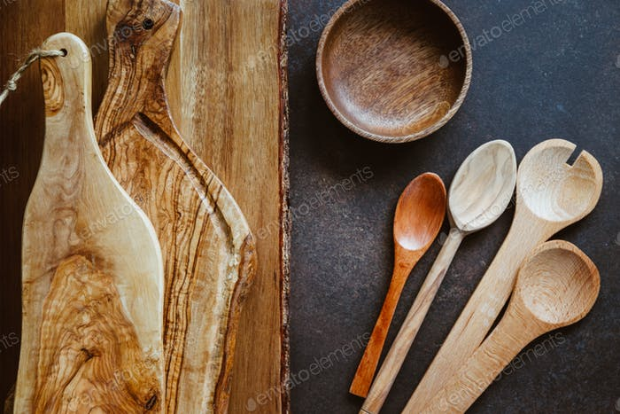 Top view of rustic wooden kitchenware. Cutting boards and spoons