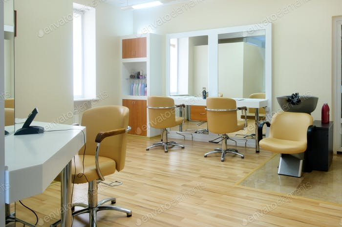 Interior of the barbershop in bright colors.Beauty salon. Place for hair cutting