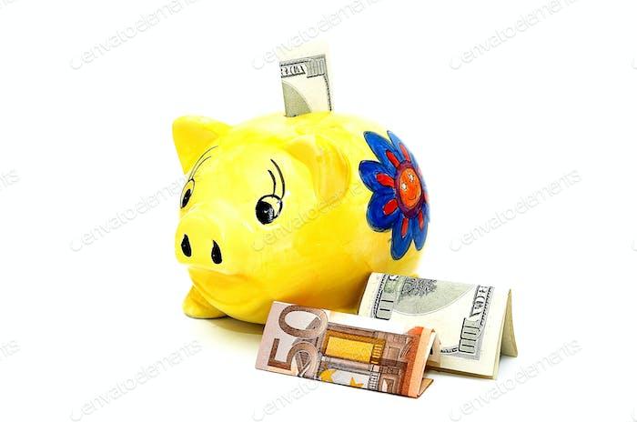 Währung und Schweinchen.