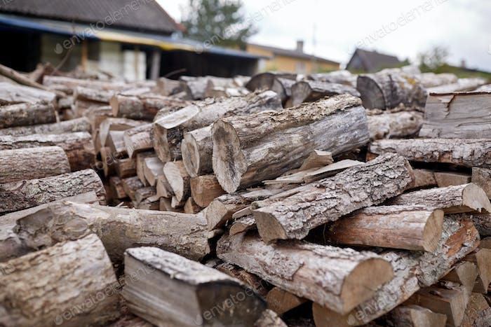 stack of firewood on farm at country