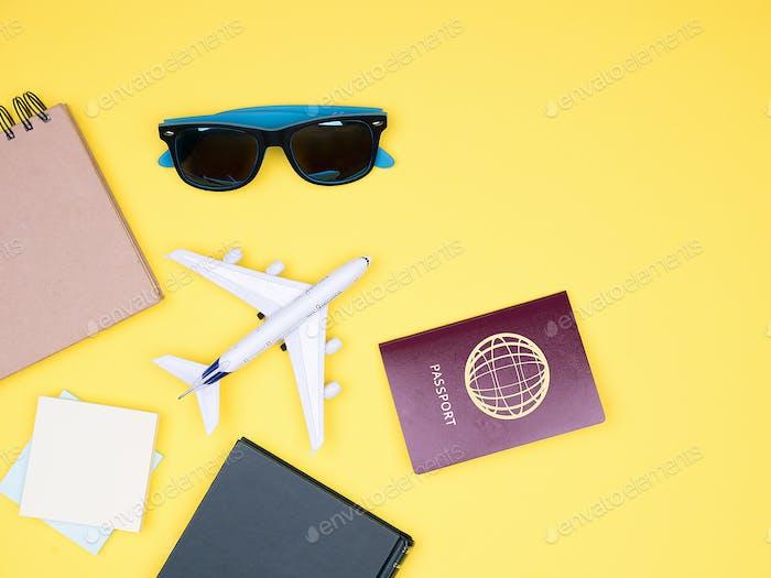 flat lay of traveler kit on yellow background