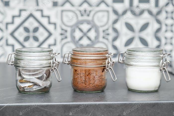 Glass jars with coffee, tea and sugar