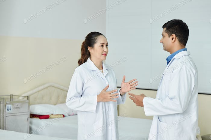 Doctor and nurse working at hospital