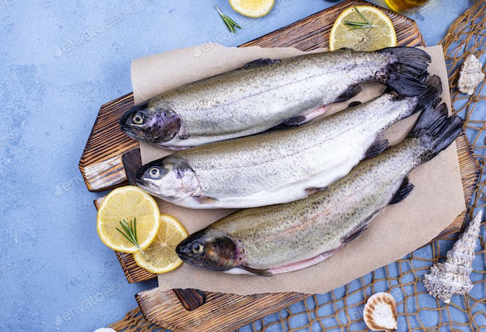 Raw uncooked trout with lemon