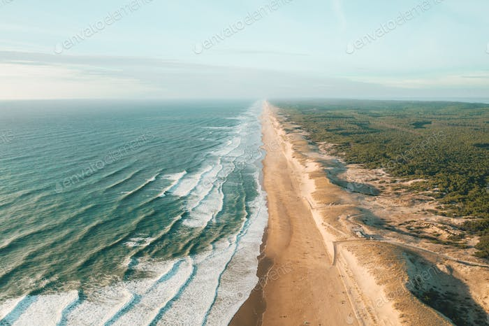 Beautiful Empty Beach in Afternoon light endless into the distance with, Aerial view from above