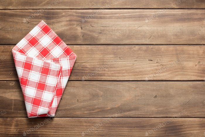 checked cloth napkin on at rustic wooden table