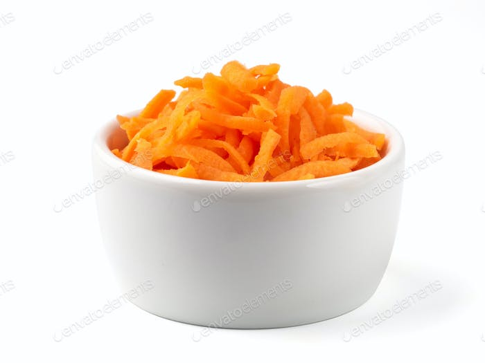 Grated carrots isolated on white